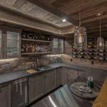 Wood Ceiling Gray Wall Brick Backsplash Granite Countertop Wet Bar Wine Storage Glass Cabinet Gray Cabinet Hanging Lamps