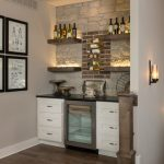 Wooden Wall Shelves Wine Fridges Beige Wall Brick Wall Dark Hardwood Floor Gallery Wall Open Shelves Stone Wall White Shaker Drawers
