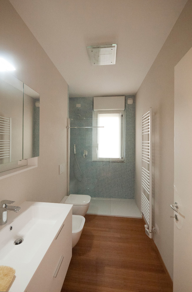 bamboo bathroom bamboo floor tile blue accent wall shower head glass door mirrored cabinet white vanity undermount sink