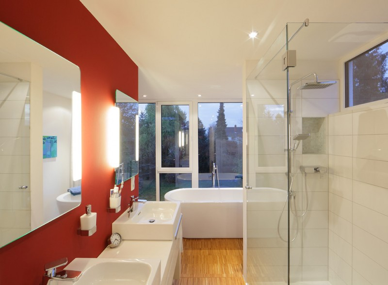 bamboo bathroom red and white walls glass windows freestanding tub white porcelain vanity and sinks shower head mirrors wall sconces