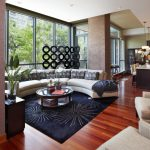Black Rugs For Living Room Floor To Ceiling Glass Windows Round Table Curved Couch Throw Pillow And Blacket Wood Floor Armchairs