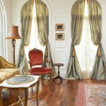Curtain Tassels Silk Curtain Red Armchair Small Wood Side Table Wood Flooring Pink Patterned Rug White Wall Oval Tray Floor Lamp
