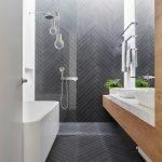 Dark Tiles Dark Tiled Floor Wall Shower Freestanding Tub Medium Tone Cabinet Marble Countertop Towel Holder Skylights Sink Full Height Mirror