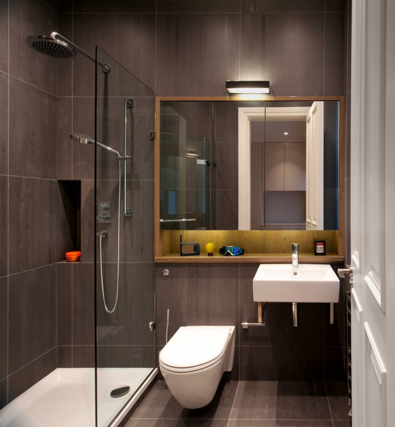 gray wall tiled wall stone tile mirror under mirror shelf open shelf wall light glass siding wall mounted toilet sink