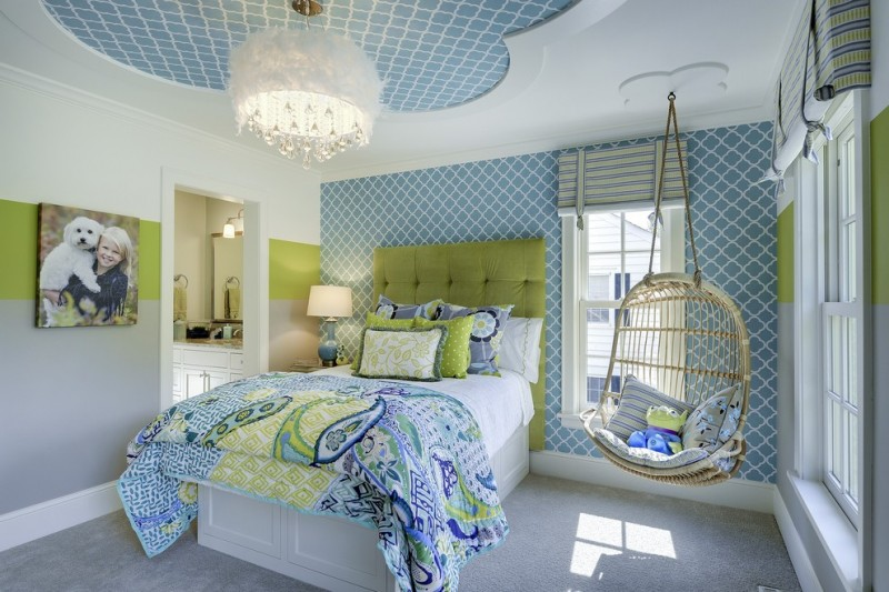 hanging papasan chairs colorful bedding ceiling style chandelier blue walls green accents green tufted headboard windows