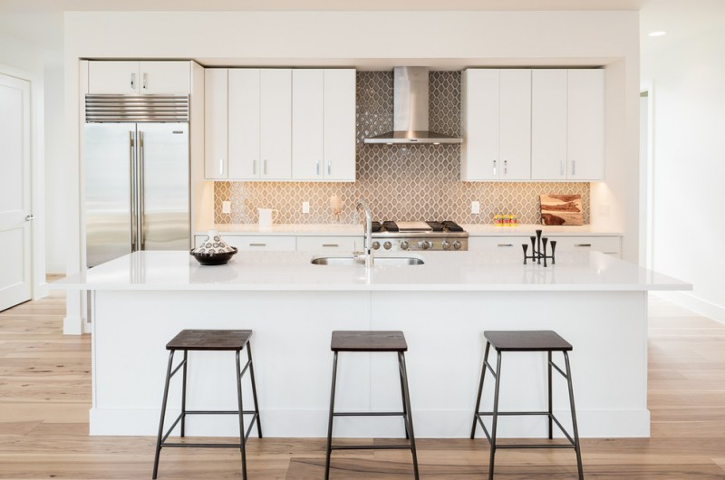 modern chic kitchen barstools white kitchen cabinets white kitchen island grey backsplash recessed lighting undermount sink hood wood floor
