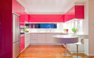 modern chic kitchen pink and white kitchen cabinets round mounted table barstool wood flooring recessed lighting white ceiling