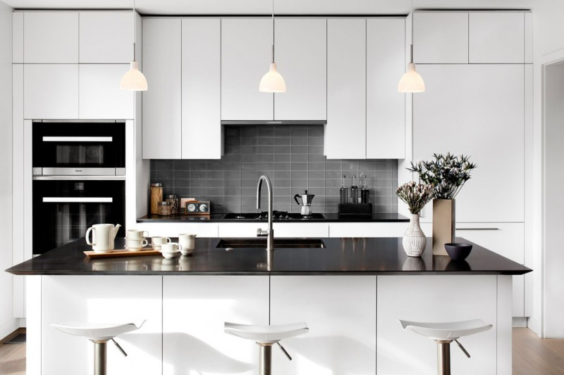 modern chic kitchen white barstools grey backsplash white cabinet white kitchen island black countertops undermount sink kitchen pendants flowers