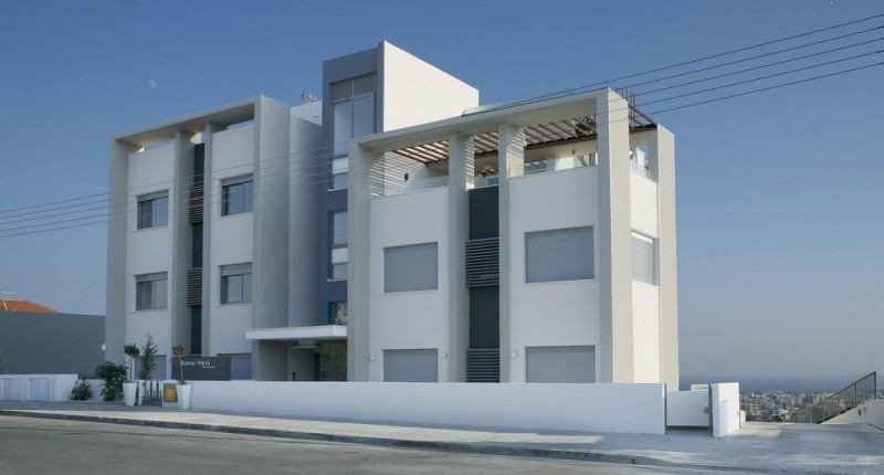 modern mansion exterior flat mansion and roofs frosted glass windows dark accent walls white and grey painted building