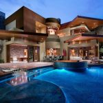 Modern Mansion Exterior Large Pool Stone Wall Wooden Exterior Recessed Lightings Bench Pool Launge Chairs Pool Lighting