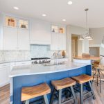 Nautical Kitchen Blue Island White Cabinets And Countertops Recessed Lighting Metalic Pendants Window Round Table Barstools