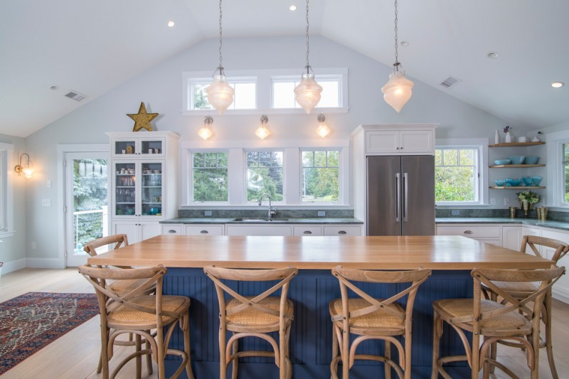 nautical kitchen dark blue kitchen island white kitchen cabinets glass windows and door wooden barstools wood countertop