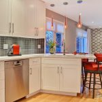 Peninsular Kitchen Red Barstools White Kitchen Cabinet Grey Backsplash Red Pendants Wood Flooring Windows With Shades