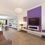 Purple Accent Walls Chandelier White Rooms Built In Shelves Table Lamp Brown Sofa Floor Lamp Glass Ceiling Skylight Beige Floor Tiles