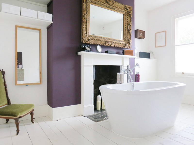 purple accent walls freestanding tub mirrors with simple and classic frames window white walls chair tub faucet white floor tile