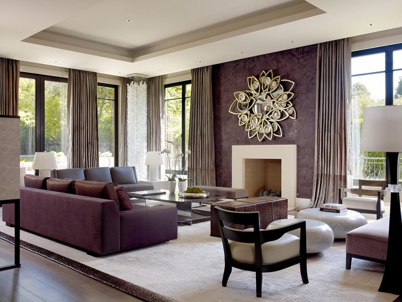 purple accent walls purple sofa mirrored coffee table fire place mirror with unique frame windows curtains large area rug