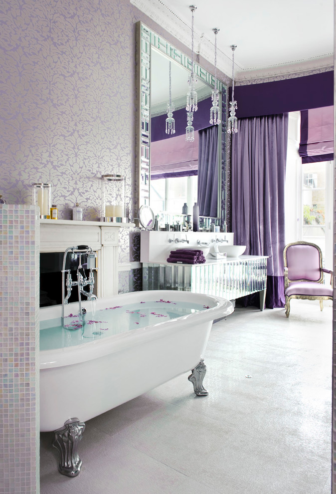 purple bathroom accessories purple drapes purple armchair purple wallpaper freestanding tub big mirror mirrored vanity sink