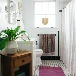 Purple Bathroom Accessories Purple Rug Shower Curtain Window Mirror Wood Cabinet Indoor Plant Wall Sconces White Vanity And Sink