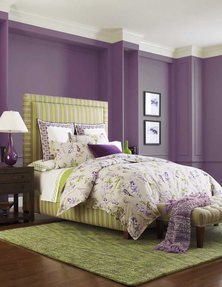 purple master bedroom green rug purple wall white ceiling stripe green bed and headboard bench framed artworks nightstands