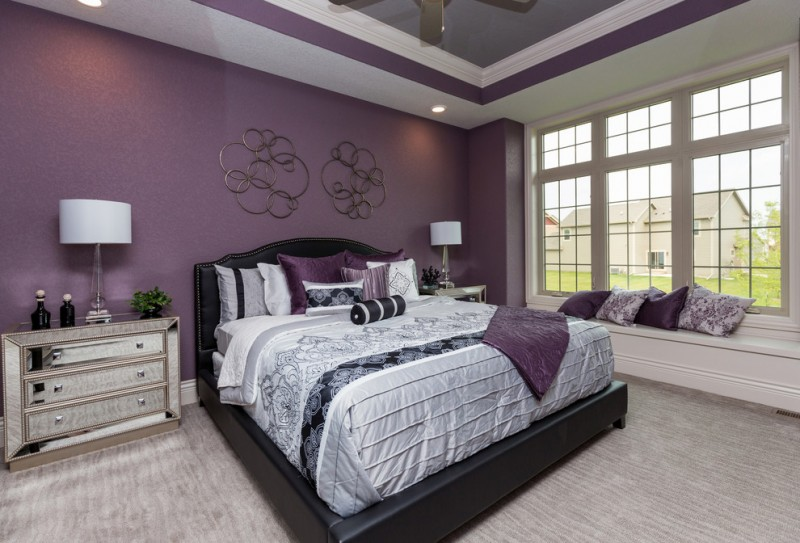 purple master bedroom purple wall rustic wall decor ceiling fan black bed silver nightstands table lamps window seat carpet