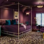 Purple Master Bedroom Purple Walls Ceiling Bedding Curtains And Chair Gold Side Table Patterned Rug Wall Sconces Tosca Nightstands