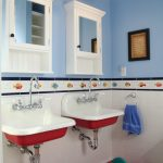 Red Bathroom Accessories Red Wall Pendants Red Bathroom Rug Blue Walls White Tile Red And White Sinks White Wall Mounted Storages With Mirrors