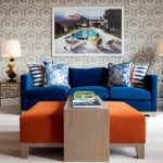 Royal Blue Sofa Patterned Wallpaper Unique Table Lamps Side Tables Big Orange Ottoman Wood Table Artwork Curtain