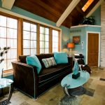 Teal And Brown Chaise Lounge Brown Sofa With Teal Lines Teal Walls Windows Oval Coffee Table Vaulted Ceiling Fireplace Stone Accent Wall