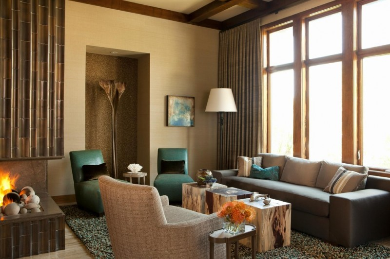 teal and brown features teal chairs grey sofa armchair cube coffee tables shag rug floor lamp side table glass windows curtain fireplace
