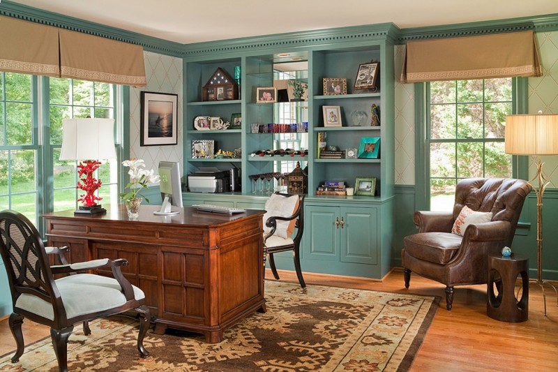 teal and brown home office carribean teal painted bookshelves and window frames brown table armchairs side table floor lamp