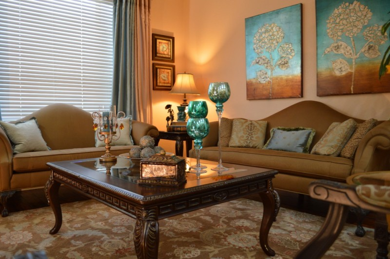 teal and brown wall decor brown sofas coffee table window curtain window shade patterned area rug side table with lamp candle