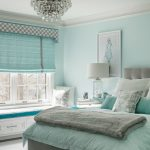 Teal Room Crystal Chandelier Art Wall Decor Blue Bedding Grey Tufted Headboard White Window Blue Window Shade Window Seat With Drawers