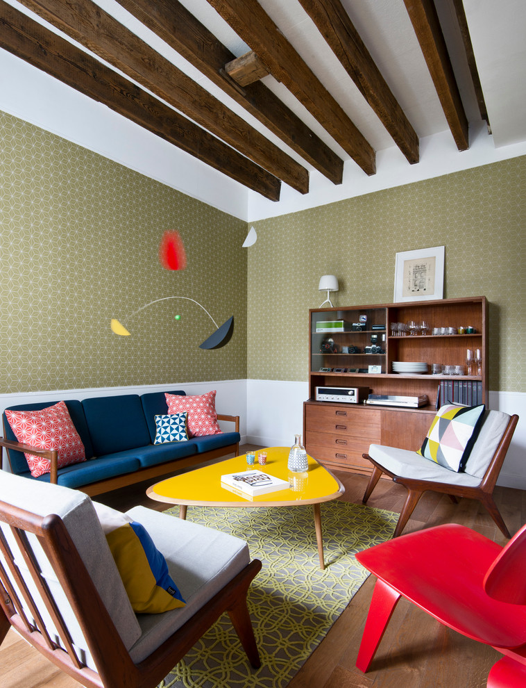 triangular table yellow table blue couch white and red chairs patterned area rug drawers ceiling beams wood floor wallpaper
