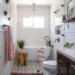 White Tiled Wall Tiled Floor Freestanding Bathtub Toilet Floating Shelf Brown Cabinet Marble Countertop Pendant Light