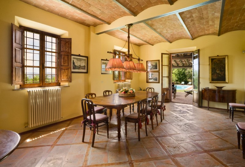 yellow dining room polca pendant lamps terra cotta ceiling yellow wall windows french door wood dining table and chair
