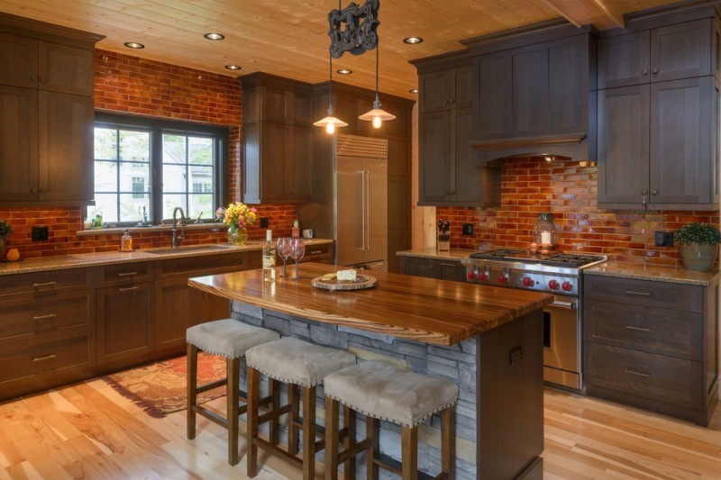 backsplash for dark cabinets red brick backsplash tiles dark wood cabinets kitchen island barstools ceiling pendants windows