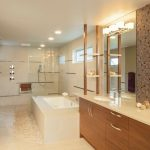 Beige Wall Stone Floor Built In Tub Shower Bench Flat Panel Cabinet Mosaic Tiled Wall Undermount Sink Granite Countertop Glass Siding Lights