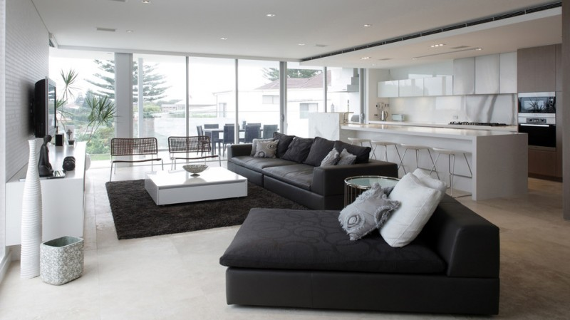 black and white living room furniture black sofa and couch white coffee table black shag rug white cabinet wall mounted tv benches