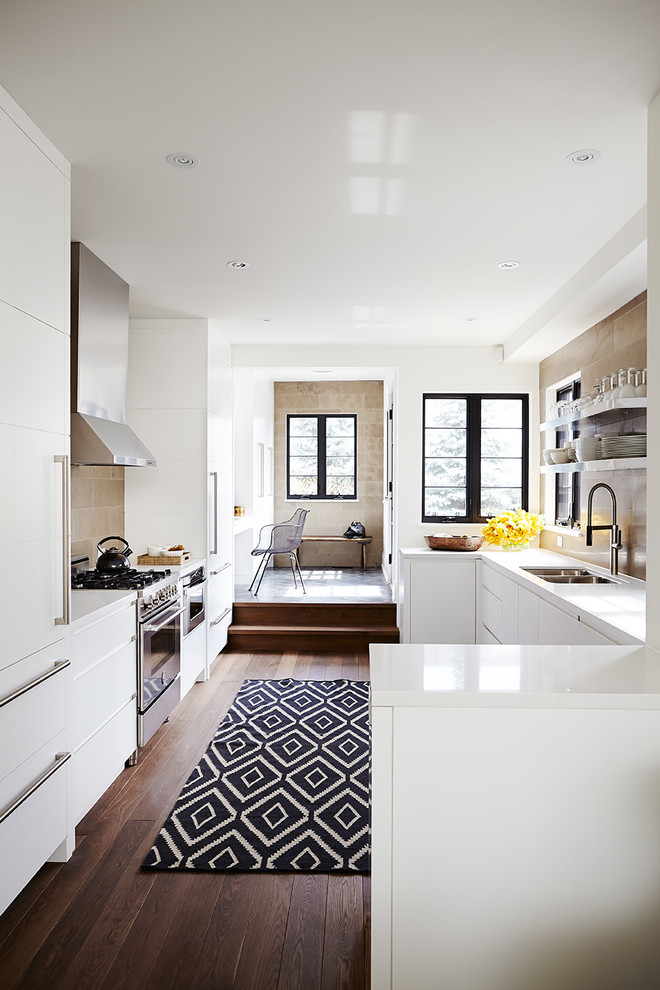 black white area rug kitchen rug white kitchen cabinets range hood windows wood flooring range hood white countertops