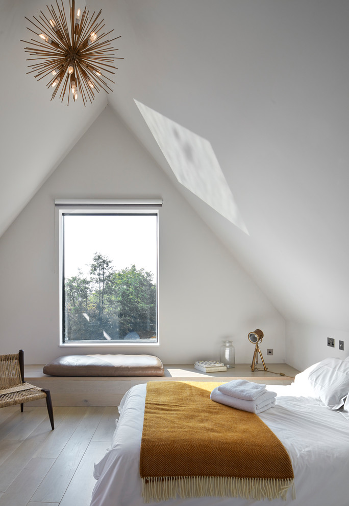 cathedral ceiling lighting sunburst chandelier white concrete walls and ceiling window white bedding window bench