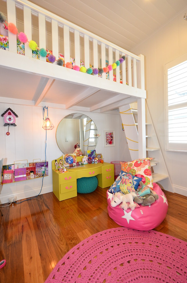 cute bean wood flooring bunk bed stairs window big round mirror pink rug yellow desk bookshelves diamond lighting