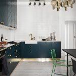 Flat Cabinet Dark Cabinet Patterned Cabinet Dining Table Granite Countertop Black Appliances Patterned Backsplash Pendant Lights