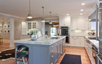 kitchen islands with sinks and dishwashers blue island granite countertop industrial pendant lights bookshelves kitchen cabinets