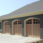 Light Wooden Garage Arched Garage One Car Garaged Grey Roof Brick Wall Black Brick Pavement Glass Window
