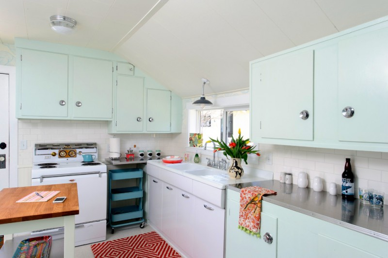 pastel kitchen baby blue and cabinets small patterned rug windows wall sconce blue rack gray countertop undermount sink