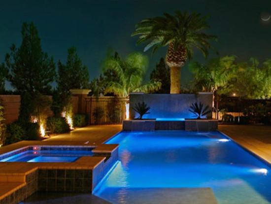 rectangular pool rectangular hot tub raised spa concrete paving palm in pool lighting