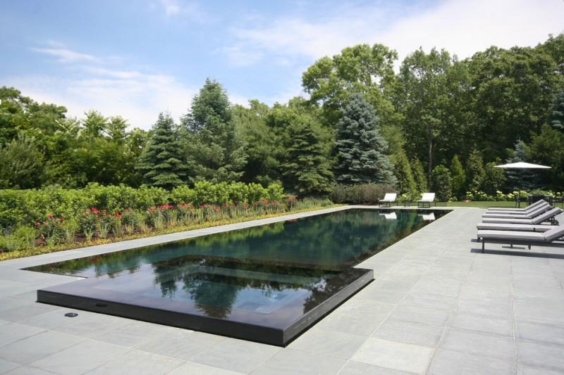rectangular pool rectangular spa black tiled pool bluestone paver pool gray pool bench flowers