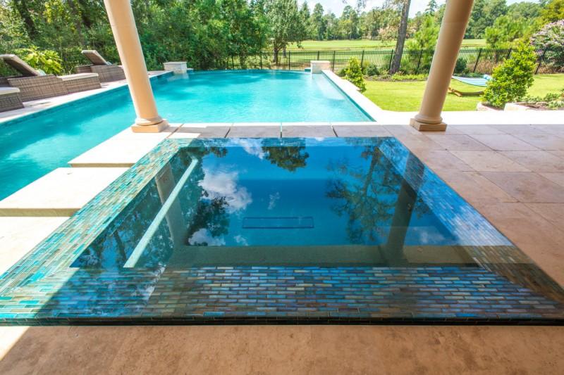 rectangular pool spa hot tub mosaic tiled edge granite floor patio pool seating backyard