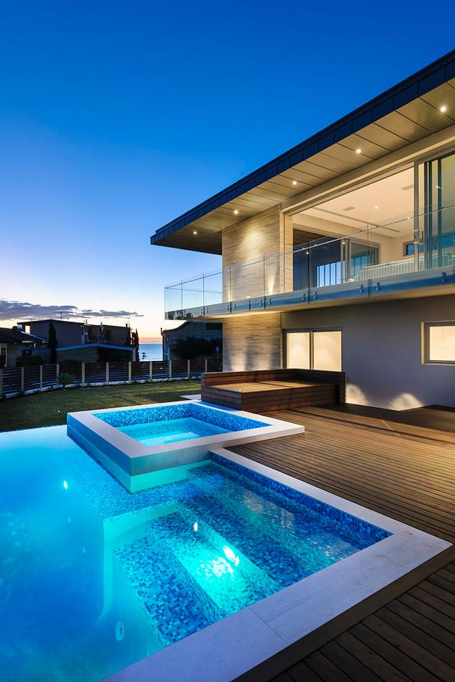 rectangular pool spa hot tub white edges wooden deck wooden bench