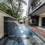 Rectangular Pool Spa Rectangular Hot Tub Granite Wall Small Fountain Wooden Deck Glass Door